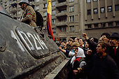 Bucharest, Romania<br /> December 1989<br /> <br /> A captured member of Ceausescu's Securitate is taken away in an armored personal carrier surrounded by acrowd seeking revenge.<br /> <br /> The week-long series of violence that overthrew the Communist regime of Nicolae Ceausescu, ended in a trial and execution of Ceausescu and his wife Elena by firing squad. Romania was the only Eastern Bloc country to violently overthrow its Communist regime or to execute its leaders.<br /> <br /> The Romanian populace was dissatisfied with the Communist regime and leader Ceausescu's economic and development policies were blamed for the country's shortages and widespread poverty. The powerful secret police (Securitate) controlled what was essentially a police state. Ceausescu was not pro-Soviet but &quot;independent&quot; on foreign policy. He imitated the hard-line, megalomania, and personality cults of communist leaders like North Korea's Kim Il Sung.
