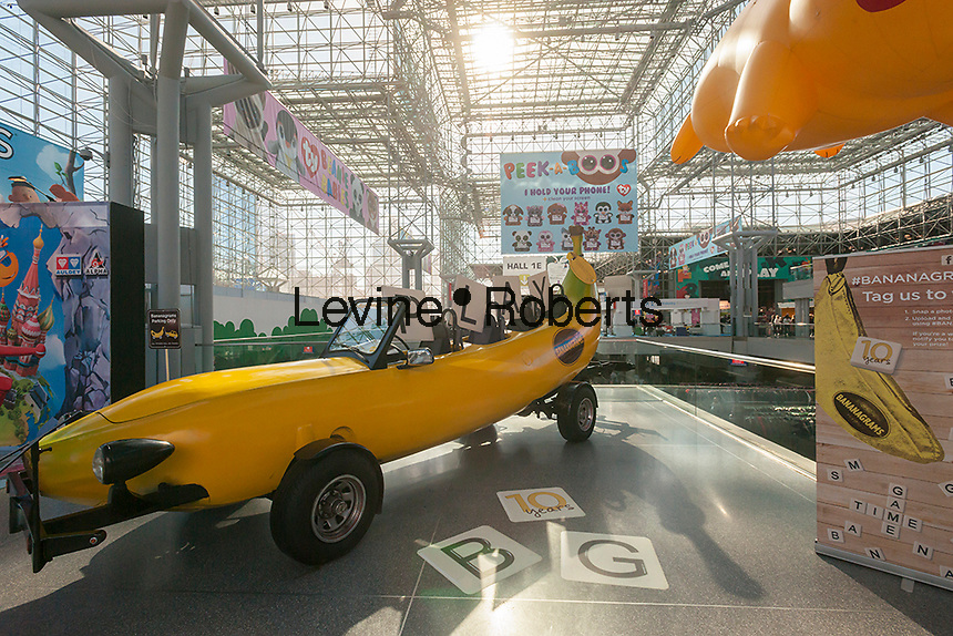 Bananagrams' Big Banana Car displayed at the 113th North American International Toy Fair in the Jacob Javits Convention center in New York on Sunday, February 14, 2016.  The company is celebrating 10 years  of its inter-generational word game. (© Richard B. Levine)