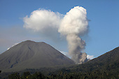 Ash and steam cloud rising from Tompaluan crater (Kawah Tompaluan) on Lokon-Empung Volcano, Sulawesi, Indonesia several hours after a larger eruption.