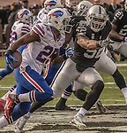 Oakland Raiders defensive end Khalil Mack (52) attempts to keep pace with Buffalo Bills running back LeSean McCoy (25) on Sunday, December 04, 2016, at O.co Coliseum in Oakland, California.  The Raiders defeated the Bills 38-24.