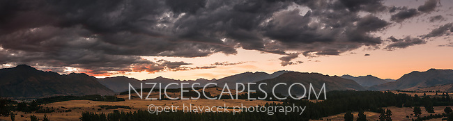 Looking west into Southern Alps across farmland at sunset from Albert Town near Wanaka, Central Otago, New Zealand, NZ