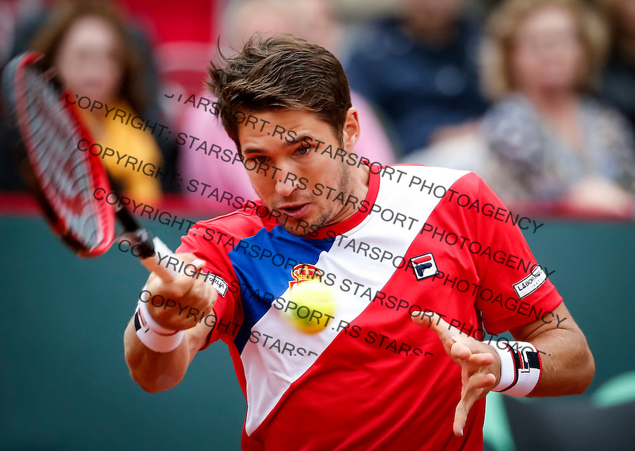 BELGRADE, SERBIA - JULY 17: Dusan Lajovic of Serbia returns the ball to Kyle Edmund of Great Britain during day three of the Davis Cup Quarter Final match between Serbia and Great Britain on Stadium Tasmajdan on July 17, 2016 in Belgrade, Serbia. (Photo by Srdjan Stevanovic/Getty Images)