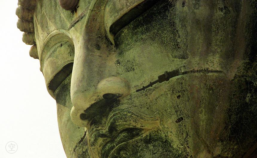 The bronze head of the Great Buddha at Kamakura, Japan.