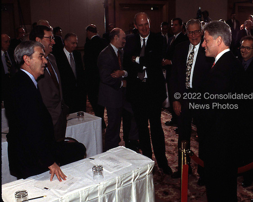 Washington, DC - February 27, 1997 - David D. Glass (Far L), President & CEO, Wal-Mart Stores, Inc. discusses business and baseball with United States President Bill Clinton.  Glass is also the Chairman of the Board and CEO of the Kansas City Royals..Credit: Ron Sachs / CNP