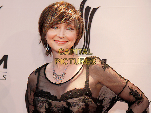 Pam Tillis.The Academy of Country Music honored artists and music industry professionals at their annual Honors Awards held at the world-famous Ryman Auditorium in downtown Nashville, TN., USA..September 24th, 2012.headshot portrait black lace .CAP/ADM/DH.©Dan Harr/AdMedia/Capital Pictures.