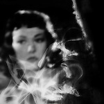 A film noir image of a woman staring behind curls of smoke