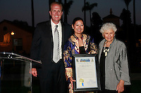 District 2 Councilmember Kevin Faulconer attend the opening of the New American Museum at the NTC Promenade in Liberty Station Friday, June 20, 2008 where he presented Executive Director Gayle Hom and Founder Deborah Szekely with a plaque from the City council.   The museum will feature exhibits, lectures and conferences related to immigration issues.  It will also house a recording studio where families can document their own immigrant history.