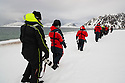 Norway, Svalbard, tourists walking in snow