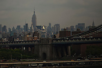 The Empire State Building and the Manhattan bridge are seen from the Brooklyn Bridge, while it remains under maintenance one day before its 130th anniversary in New York,  May 23, 2013, Photo by Eduardo Munoz Alvarez / VIEWpress.
