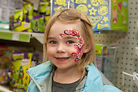 Phoebe Watson, 4 of Chesterfield, who had her face painted by Chryl Whitfield in the new store