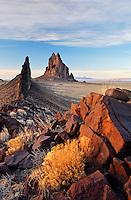 Shiprock Rock and black dike ridge, New Mexico, USA