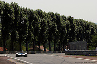 LE MANS, FRANCE: A prototype entry is driven through Tertre Rouge toward the Mulsanne Straight during the 24 Hours of Le Mans on June 16, 2002, at Circuit de la Sarthe in Le Mans, France.