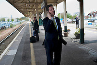 Nick Clegg, the Liberal Democrat party leader, talks on his mobile phone as he waits for a train to take him back to London after visiting Chippenham in Wiltshire on the campaign trail..