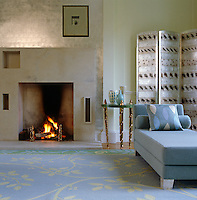 Corner of a contemporary sitting room towards the fireplace