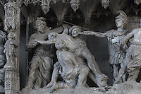 Jesus' cross is erected by soldiers, detail from The Crucifixion, by Simon Mazieres, 1713-16, from the choir screen, Chartres Cathedral, Eure-et-Loir, France. Chartres cathedral was built 1194-1250 and is a fine example of Gothic architecture. It was declared a UNESCO World Heritage Site in 1979. Picture by Manuel Cohen.