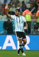 Ezequiel Garay of Argentina gestures as he wears only one boot