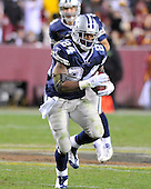 Landover, MD - November 16, 2008 -- Dallas Cowboys running back Marion Barber (24) carries the ball late in the fourth quarter against the Washington Redskins at FedEx Field in Landover, Maryland on Sunday, November 16, 2008.  Barber finished the game with 114 yards on 24 carries.  Dallas won the game 14 - 10..Credit: Ron Sachs / CNP