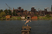 Mariupol, Ukraine.July 29, 2005 ..Residents swim and fish in the river that runs along side the Azovstal steel factory......