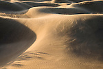 The wind blows the sand over the Mesquite Sand Dunes, Death Valley National Park, Nevada, United States of America.