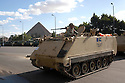 Egyptian soldiers in a armored personnel carrier hold a security position in front of the Pyramids in the Giza district of Cairo, Egypt January 31, 2010. The presence of the army at key points across the country seems to have partially brought a sense of near normalcy to many areas despite ongoing protests.