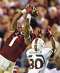 Kelvin Benjamin goes up over AJ Highsmith as the #3 ranked Florida State Seminoles rolled over the #7 ranked Miami Hurricanes 41-14 in Tallahassee, FL November 3, 2013.