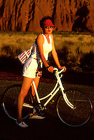 Ayers Rock Australia, Girl on a old fashion Bike