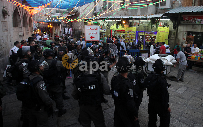 Israeli policemen stand guard as they barring entrance to the al-Aqsa mosque to men younger than 50 years,  to mark Laylat al-Qadr, or Night of Destiny, in Jerusalem's Old City on July 24, 2014. On Friday, dozens of Palestinian youths clashed with Israeli police near Jerusalem's Old City and clashes erupted in other parts of the West Bank near Hebron and Nablus. Israel forces killed four Palestinians during West Bank protests against Israel's military operation in the Gaza Strip, Palestinian hospital officials said. Photo by Saeed Qaq