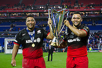 Mako and Billy Vunipola of Saracens lift the European Rugby Champions Cup trophy. European Rugby Champions Cup Final, between Saracens and Racing 92 on May 14, 2016 at the Grand Stade de Lyon in Lyon, France. Photo by: Patrick Khachfe / Onside Images