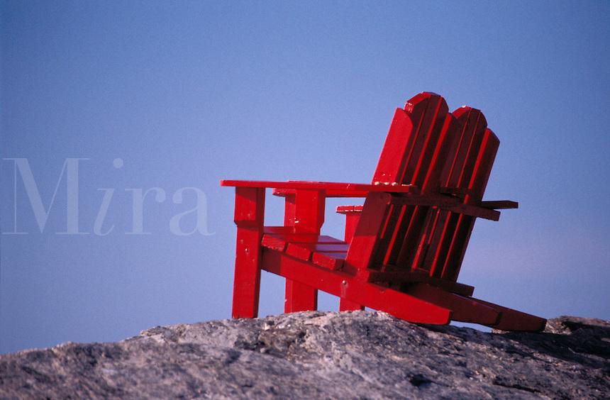 Adirondak chairs on rocky outlook.