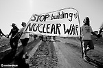 Protesters marched onto the construction site of a new plant being built to manufacture non-nuclear components for nuclear weapons. Additional issues were the contamination of the Bannister site and the questionable financing for this government project.