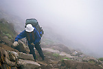 Backpacker on Phantom Terrace in the clouds, Sangre de Cristo Wilderness, San Isabel National Forest, Colorado