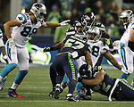 Carolina Panthers running back Jonathan Stewart (28) is ganged tackled by Seattle Seahawks outside linebacker Mike Morgan (57),  defensive end Michael Bennett (72) and outside linebacker K.J. Wright (50) at CenturyLink Field in Seattle, Washington on December 4, 2016.  Seahawks beat the Panthers 40-7.  ©2016. Jim Bryant photo. All Rights Reserved.