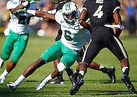 WEST LAFAYETTE, IN - SEPTEMBER 29: Dominick LeGrande #6 of the Marshall Thundering Herd prepares to tackle O.J. Ross #4 of the Purdue Boilermakers at Ross-Ade Stadium on September 29, 2012 in West Lafayette, Indiana. (Photo by Michael Hickey/Getty Images) *** Local Caption *** Dominick LeGrande; O.J. Ross