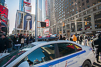Tight security on opening day of Super Bowl Boulevard in Midtown Manhattan in New York on Wednesday, January 29, 2014. Despite the game being held in New Jersey on February 2 sports fans are expected to pack New York to take part in the multitude of activities planned around the game including the 13 block stretch of Broadway, running from 34th street through 47th street that will host Super Bowl Blvd. from January 29 to February 1. (© Richard B. Levine)