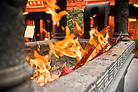 Prayer inscense being burned in Chinese temple