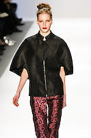 Marique Schimmel walks the runway in a Luca Luca Fall 2011 outfit, designed by Raul Melgoza, during Mercedez-Benz Fashion Week, February 10, 2011