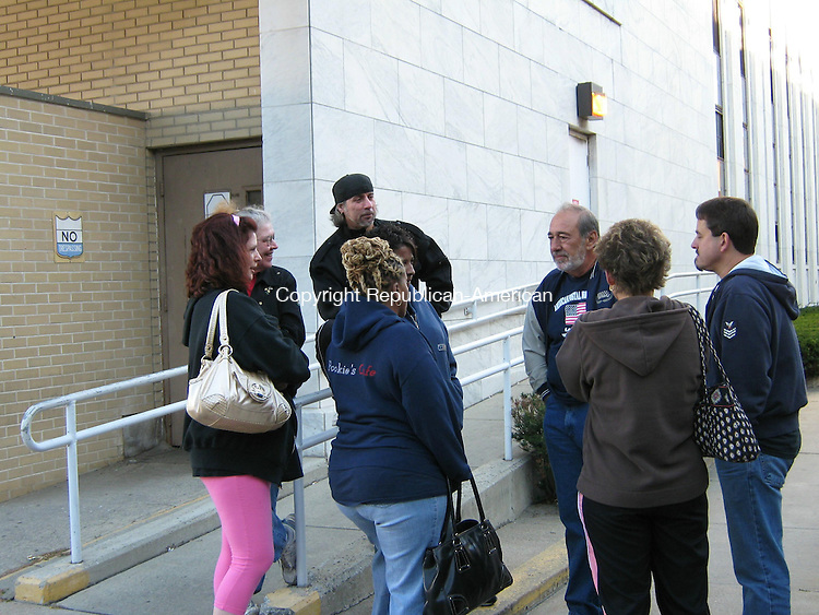 WATERBURY, CT - 8 Oct. 2009 - 100809AL01 - Ray Arcovio, center right, president of the local American Postal Workers Union, talks to employees whose jobs are in jeopardy Thursday outside the U.S. Postal Service office on Grand Street.