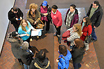 Melville, New York, USA. 24th January 2017. Fourteen members of Together We Will Long Island gather in lobby of bulding that U.S. Senator Chuck Schumer of New York has his Melville office in. They discussed plans before stopping by Schumer's office to share their concerns, especially about Trump's Cabinet appointees, #SwampCabinet. TWWLI members included, clockwise starting left, (in black cap) SHERRY MEDEROS, of Copiague; (in light blue TWWLI shirt) administrator SUE MOLLER of Merrick; social media director JUAN ALICEA, of Medford; member; (in blue cap) ANDREA ROSS BOYLE, of Dix Hills; (in coral sweater) TEDRA GRANT, of Dix Hills; member; (at upper right) PHILIP SOLIS, of Dix Hills; member; (holding coat) ERICA DORAN, of Syosset; LAURIE MITCHEL, of West Babylon; This Stop Trump Tuesday, #StopTrumpTuesday, event was part of nationwide political movement. Members of organizations such as MoveOn, Indivisible, and TWW plan to visit their Senators' offices each Tuesday duringTrump's first 100 days of presidency.