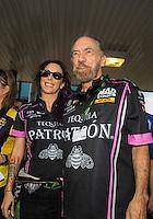 Oct 16, 2016; Ennis, TX, USA; NHRA funny car driver Alexis DeJoria (left) and father John Paul DeJoria during the Fall Nationals at Texas Motorplex. Mandatory Credit: Mark J. Rebilas-USA TODAY Sports