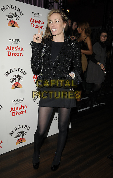 TARA PALMER TOMKINSON .At the Malibu presents Alesha Dixon new cocktail range launch party, Studio Valbonne nightclub, London, England, UK, November 12th 2010..full length dress mini tights jacket patent shoes  TPT pleated skirt kilt  hand .CAP/CAN.©Can Nguyen/Capital Pictures.