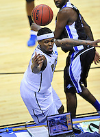 Nasir Robinson of the Panthers tries to save the ball. Pittsburgh defeated UNC-Asheville 74-51 during the NCAA tournament at the Verizon Center in Washington, D.C. on Thursday, March 17, 2011. Alan P. Santos/DC Sports Box