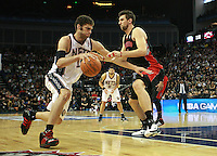 Basketball - NBA - New Jersey Nets vs. Toronto Raptors..Brook Lopez of the Nets drives to the net at the O2, London