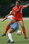24 September 2006: Miami's Rachael Rigamat (4) and UNC's Kristi Eveland (behind). The University of North Carolina Tarheels defeated the University of Miami Hurricanes 6-1 at Fetzer Field in Chapel Hill, North Carolina in an NCAA Division I women's soccer game.