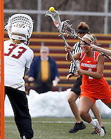 Syracuse University midfielder Erica Bodt (4) takes a shot.  Syracuse University (orange) defeated Boston College (white), 17-12, on the Newton Campus Lacrosse Field at Boston College, on March 27, 2013.
