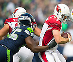 Seattle Seahawks  defense end Cliff Avril (51) sacks Arizona Cardinals Drew Stanton (5) at CenturyLink Field in Seattle, Washington on November 23, 2014. The Seahawks beat the Cardinals 19-3.  ©2014. Jim Bryant Photo. All Rights Reserved.