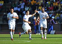 Edson Buddle of USA is congratulated by his captain Carlos Bocanegra after scoring..Football - International Friendly - USA v Australia - Ruimsig Stadium, June 5, 2010.