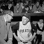 Pittsburgh PA:  Public Relations man Bill Wilde talking with all-time great Pie Trainor in the dugout at the HYPO charity baseball game with the Cleveland Indians - 1964.<br />