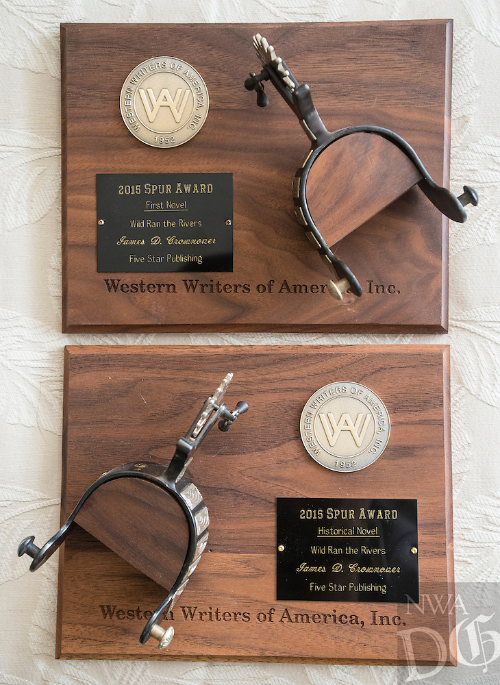 NWA Democrat-Gazette/ANTHONY REYES &bull; @NWATONYR<br /> James Crownover's two Spur awards Thursday, Sept. 24, 2015 at his home in Elm Springs. Crownover won two Spur awards for his first published western novel.