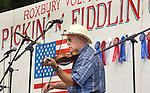 ROXBURY CT. 11 July 2015-071115SV01-Rejean Paquet of Naugatuck plays a song during the annual Pickin' 'N' Fiddlin' fundraiser at Hurlburt Park in Roxbury Saturday.<br /> Steven Valenti Republican-American