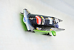 17 December 2010:  Cathleen Martini pilots her 2-man bobsled for Germany, finishing 3rd for the day at the Viessmann FIBT World Cup Bobsled Championships in Lake Placid, New York, USA. The event was a Make-up Race from the previous week at Park City where the Women's Bobsled had to be cancelled due to severe snow conditions. Mandatory Credit: Ed Wolfstein Photo